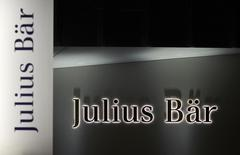 The logo of Swiss private bank Julius Baer is pictured on the company's branch in Lausanne November 13, 2014.  REUTERS/Denis Balibouse
