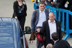 Greek Finance Minister Yanis Varoufakis (front) and Chief Economics Spokesman of the Government of Greece Euclid Tsakalotos leave a Eurozone finance ministers emergency meeting in Brussels, Belgium, June 24, 2015. REUTERS/Philippe Wojazer