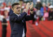 June 11, 2015; Edmonton, Alberta, CAN; Canada head coach John Herdman reacts to fans following the 0-0 draw against New Zealand in a Group A soccer match in the 2015 FIFA women's World Cup at Commonwealth Stadium. Mandatory Credit: Erich Schlegel-USA TODAY Sports