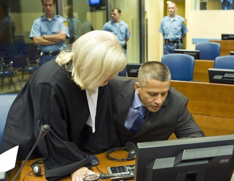Bosnian Muslim Naser Oric (R) and his lawyer Vasvija Vidovic sit in the courtroom of the International Criminal Tribunal for the former Yugoslavia (ICTY) as he waits for the judgement on his appeal against his war crimes conviction in The Hague July 3, 2008. REUTERS/Zoran Lesic/Pool