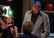 Jun 25, 2015; Brooklyn, NY, USA; NBA draft pick  Karl-Anthony Towns walks off the stage after being picked first in the 2015 NBA draft at Barclays Center. Mandatory Credit: Brad Penner-USA TODAY Sports -