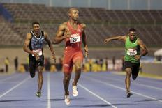Jamaica's Asafa Powell (C) competes in the men's 100m during the national trials at the National Stadium in Kingston, Jamaica June 25, 2015.  REUTERS/Gilbert Bellamy  -
