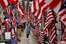 Brenda Sabb inspects U.S. flags at Valley Forge's manufacturing facility in Lane, South Carolina June 23, 2015. Prominent U.S. flag makers said on Tuesday they will stop manufacturing and selling Confederate battle flags after last week's attack on worshippers at a black church in Charleston, South Carolina. Reggie VandenBosch, vice president of sales at privately owned Valley Forge Flag, said the Pennsylvania-based company came to the decision as pressure grew on South Carolina to remove the banner from outside the State House in Columbia. The 133-year-old company sells millions of flags each year, VandenBosch said, with Confederate flags making up only a tiny slice of that business. REUTERS/Brian Snyder