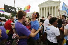 Gay rights supporters celebrate after the U.S. Supreme Court ruled that the U.S. Constitution provides same-sex couples the right to marry, outside the Supreme Court building in Washington, June 26, 2015. REUTERS/Jim Bourg