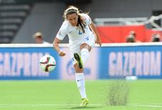 Jun 22, 2015; Ottawa, Ontario, CAN; England midfielder  Fara Williams (4) kicks the ball against the Norway during the first half in the round of sixteen in the FIFA 2015 women's World Cup soccer tournament at Lansdowne Stadium. Mandatory Credit: Marc DesRosiers-USA TODAY Sports