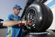 Renault Formula One team mechanic Steve Larney of Ireland balances a wheel on a Michelin-shod wheel at the Indianapolis Motor Speedway June 29, 2006. REUTERS/John Gress