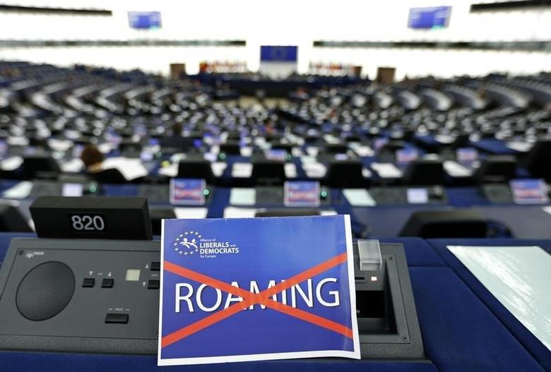 A paper with the word ''Roaming'', crossed out, is seen on the desk of a Member of the European Parliament during a debate in Strasbourg, March 11, 2015.            REUTERS/Vincent Kessler