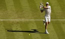 Andy Murray of Britain hits a shot during his match against Mikhail Kukushkin of Kazakhstan at the Wimbledon Tennis Championships in London, June 30, 2015.   REUTERS/Henry Browne