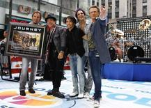 Journey band members (L-R) Jonathan Cain, Neal Schon, Arnel Pineda, Deen Castronovo, and Ross Valory pose together after performing on NBC's Today Show in New York July 29, 2011.  REUTERS/Lucas Jackson