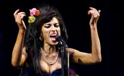 British singer Amy Winehouse performs at the Glastonbury Festival 2008 in Somerset in south west England in this June 28, 2008 file photo. REUTERS/Luke MacGregor/Files