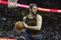 Apr 10, 2015; Cleveland, OH, USA; Cleveland Cavaliers forward Kevin Love (0) rebounds in the second quarter against the Boston Celtics at Quicken Loans Arena. Mandatory Credit: David Richard-USA TODAY Sports