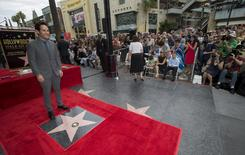 Actor Paul Rudd poses by his star after it was unveiled on the Walk of Fame in Hollywood, California July 1, 2015.  REUTERS/Mario Anzuoni