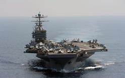 The Nimitz-class aircraft carrier USS Abraham Lincoln transits the Indian Ocean in this U.S. Navy handout photo dated January 18, 2012.   REUTERS/U.S. Navy/Chief Mass Communication Specialist Eric S. Powell/Handout