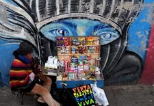 A street vendor sells candies and cigarettes in the centre of  La Paz, July 1, 2015. REUTERS/David Mercado