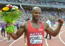 Asafa Powell (JAM) poses after winning the 100m in 9.81 during the 2015 Meeting Areva at Stade de France. Mandatory Credit: Kirby Lee-USA TODAY Sports