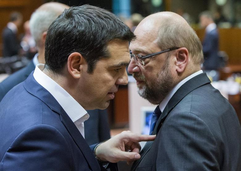 Greek Prime Minister Alexis Tsipras (L) talks to European Parliament President Martin Schulz at a European Union leaders summit in Brussels, Belgium, June 25, 2015.  REUTERS/Yves Herman