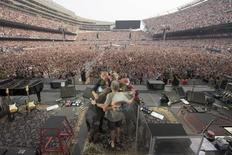 The rock band The Grateful Dead embraces during their final concert at Soldier Field stadium in Chicago, Illinois July 5, 2015, in this handout courtesy of Jay Blakesberg.   REUTERS/Copyright by Jay Blakesberg/Handout