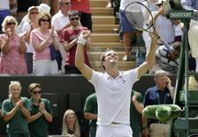 Richard Gasquet of France celebrates after winning his match against Nick Kyrgios of Australia at the Wimbledon Tennis Championships in London, July 6, 2015.                REUTERS/Henry Browne
