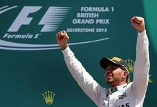 Formula One - F1 - British Grand Prix 2015 - Silverstone, England - 5/7/15 Mercedes' Lewis Hamilton celebrates his win on the podium. Reuters / Paul Childs