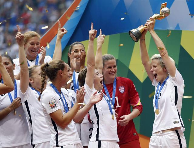 United States midfielder Megan Rapinoe (15) celebrates with teammates after defeating Japan in the final of the FIFA 2015 Women's World Cup in Vancouver July 5, 2015.  Mandatory Credit: Michael Chow-USA TODAY Sports