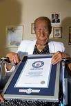 Susannah Mushatt Jones is pictured with a certificate from Guinness World Records proclaiming her as the world's oldest woman in New York in this July 3, 2015 handout photo obtained by Reuters July 6, 2015.  REUTERS/Philip Robertson/Guinness World Records/Handout via Reuters