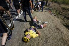Race leader and yellow jersey holder Trek Factory rider Fabian Cancellara of Switzerland lies on the ground after a fall during the 159,5 km (99 miles) third stage of the 102nd Tour de France cycling race from Anvers to Huy, Belgium, July 6, 2015. REUTERS/Eric Gaillard