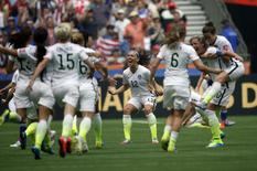 United States midfielder Lauren Holiday (12) celebrates with teammates after defeating Japan in the final of the FIFA 2015 Women's World Cup at BC Place Stadium in Vancouver July 5, 2015. Mandatory Credit: Michael Chow-USA TODAY Sports