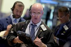 Traders work on the floor of the New York Stock Exchange July 6, 2015. REUTERS/Brendan McDermid