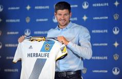 Jul 7, 2015; Los Angeles, CA, USA; Los Angeles Galaxy midfielder Steven Gerrard poses for photos following his introduction to media at Stubhub Center. Mandatory Credit: Gary A. Vasquez-USA TODAY Sports