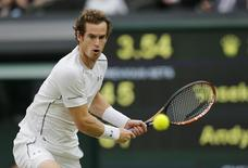 Andy Murray of Britain hits a shot during his match against Vasek Pospisil of Canada at the Wimbledon Tennis Championships in London, July 8, 2015.                           REUTERS/Suzanne Plunkett
