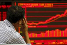 An investor watches an electronic board showing stock information at a brokerage office in Beijing, China, July 9, 2015. REUTERS/Kim Kyung-Hoon