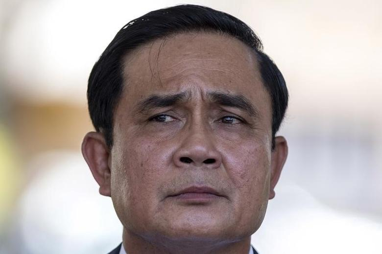 Thailand's Prime Minister Prayuth Chan-ocha listens to a question from a journalist after a ceremony to mark the National Anti Human Trafficking Day at Government House in Bangkok, Thailand, June 5, 2015.   REUTERS/Athit Perawongmetha