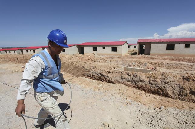 A Chinese worker walks past a construction site in Lubango, Angola March 5, 2014. REUTERS/Herculano Coroado