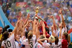 United States players react as they receive the FIFA Women's World Cup trophy after defeating Japan in the final of the FIFA 2015 Women's World Cup at BC Place Stadium. Anne-Marie Sorvin-USA TODAY Sports