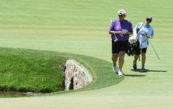 Laura Davies and caddie Tanya Peterson walk up the seventh fairway during the third round of the 2015 U.S. Women's Open at Lancaster Country Club. Mandatory Credit: Kyle Terada-USA TODAY Sports