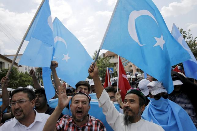 Demonstrators shout slogans as they attend a protest in front of the Thai Embassy in Ankara, Turkey, July 9, 2015. Thailand confirmed on Thursday it had forcibly returned nearly 100 Uighur migrants to China, heightening tensions between Ankara and Beijing over the treatment of the Turkic language-speaking and largely Muslim minority. REUTERS/Umit Bektas