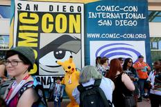 Attendees wait outside of the San Diego Convention Center to receive their entry badges at the 2015 Comic-Con International in San Diego, California July 8, 2015. REUTERS/Sandy Huffaker