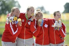 Jul 11, 2015; Welland, Ontario, CAN; (left to right) Michelle Russell, Emilie Fournel, KC Fraser and Hannah Vaughan of Canada celebrate winning in the Women K4 500m Final during the 2015 Pan Am Games at Welland Pan Am Flatwater Centre.  Eric Bolte-USA TODAY Sports