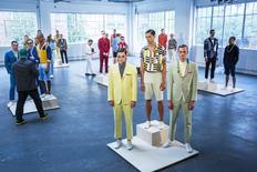 Models stand on pedestals for the David Hart presentation during Men's Fashion Week, in New York, July 13, 2015. The four-day event by the Council of Fashion Designers of America is the New York debut of Fashion Week: Men's. REUTERS/Lucas Jackson