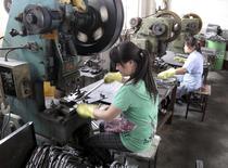 Workers make metal parts at a factory of the Changzhou Wujin Zhengda Vehicle Industry Co. Ltd in Changzhou, Jiangsu province, China, July 9, 2015. REUTERS/John Ruwitch