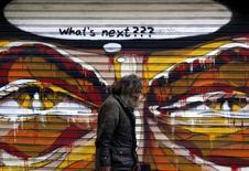 A man walks by a mural in Athens, Greece July 14, 2015. REUTERS/Yannis Behrakis