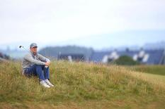 Jordan Spieth of the U.S. takes a rest on the fourth hole during a practice round ahead of the British Open golf championship on the Old Course in St. Andrews, Scotland, July 14, 2015.    REUTERS/Eddie Keogh