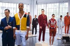 Models stand on pedestals for the David Hart presentation during Men's Fashion Week, in New York, July 13, 2015. REUTERS/Lucas Jackson