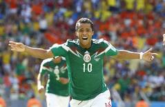 Mexico's Giovani Dos Santos celebrates after scoring a goal against the Netherlands during their 2014 World Cup round of 16 game at the Castelao arena in Fortaleza June 29, 2014. REUTERS/Murad Sezer/Files
