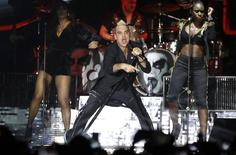 Singer Robbie Williams performs on stage during a concert to celebrate the tenth anniversary of the reign of Albert II, in front of the  Palace in Monaco, July 12, 2015. REUTERS/Lionel Cironneau