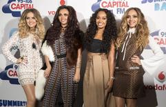 Members of the pop group Little Mix pose for photographers at the Capital Summertime Ball at Wembley Stadium in London, Britain June 06, 2015. REUTERS/Neil Hall
