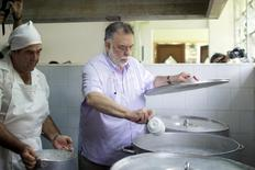 U.S. director Francis Ford Coppola (R) prepares pasta in the kitchen of the International School of Cinema and Television (EICTV) in San Antonio de los Banos, Cuba, July 16, 2015. REUTERS/Alexandre Meneghini