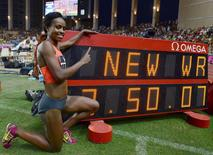 Genzebe Dibaba of Ethiopia celebrates her new world record in the 1500 meters women event at the IAAF Diamond League Herculis meeting at the Louis II Stadium in Monaco, July 17, 2015. REUTERS/Jean-Pierre Amet