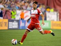 New England Revolution forward Lee Nguyen (24) controls the ball against the New York City FC during the second half of the New England Revolution's 1-0 win over New York City FC at Gillette Stadium. Winslow Townson-USA TODAY Sports
