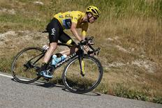 Team Sky rider Chris Froome of Britain, wearing the race leader's yellow jersey, rides during the 201-km (124 miles) 16th stage of the 102nd Tour de France cycling race from Bourg-de-Peage to Gap, France, July 20, 2015. REUTERS/Benoit Tessier